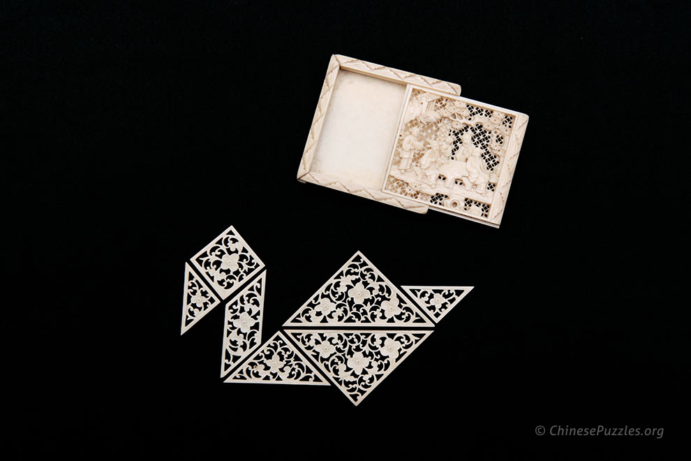 carved ivory tangram pieces