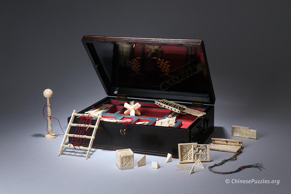Chinese games box with ivory puzzles